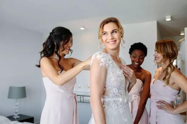 The bride's dress was simple versus her friend's elaborate gown