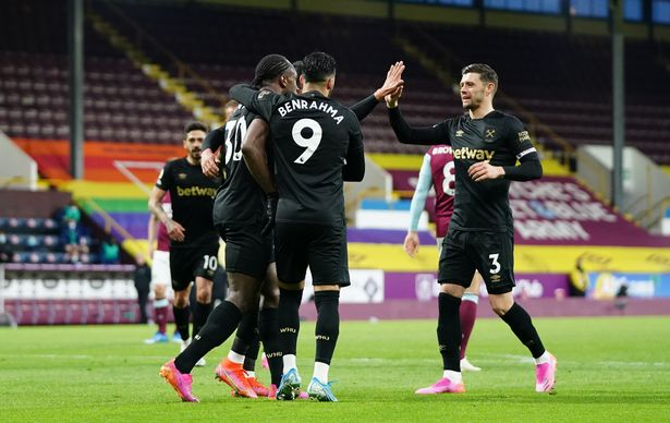 Michail Antonio of West Ham United celebrates with teammates Said Benrahma and Aaron Cresswell (Photo by Jon Super - Pool / Getty Images)