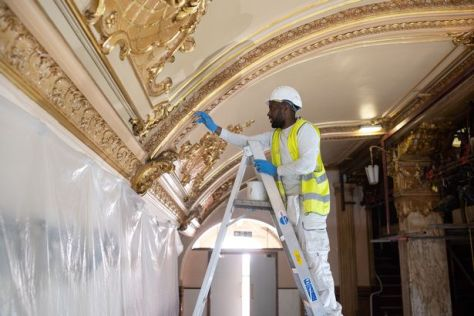 A specialist painter works on the major conservation project taking place in the Blackpool Tower Ballroom, in Blackpool, northern England on April 20, 2021