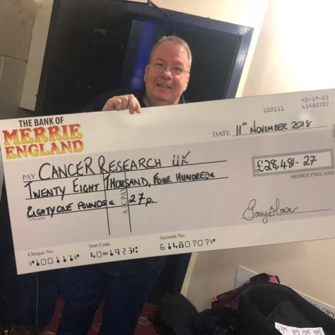 Joey Blower with cheque for Cancer Research for over £28,000