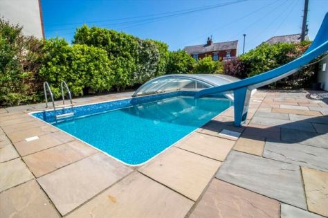 Heated outdoor swimming pool with cover