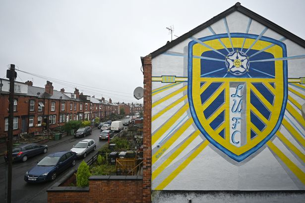 A graffiti mural depicting the emblem of Leeds United, is pictured on the side of a house in Leeds, on August 16, 2020