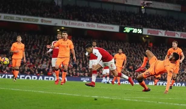 Alexis Sanchez of Arsenal scores against Liverpool