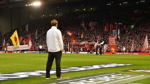 Jurgen Klopp manager of Liverpool watches the Kop