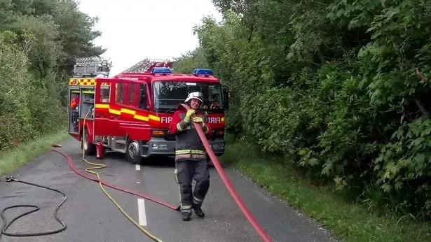 Adam Martin does his job as a fireman