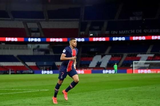 PARIS, FRANCE - FEBRUARY 21: Kylian Mbappe of Paris Saint-Germain watches during the Ligue 1 football match between Paris Saint-Germain and AS Monaco at the Parc des Princes on February 21, 2021 in Paris, France.  (Photo by Aurelien Meunier - PSG / PSG via Getty Images)