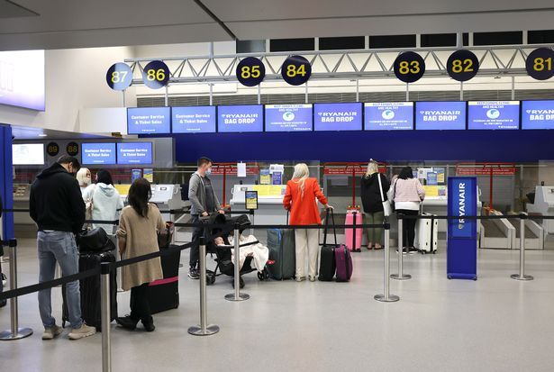 Passenger queues at the check-in counter