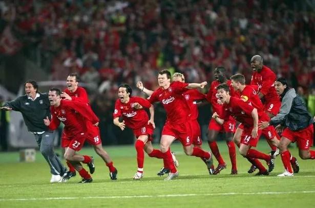 Liverpool players run to celebrate after Jerzy Dudek saved AC Milan's Andrei Shevchenko's last penalty