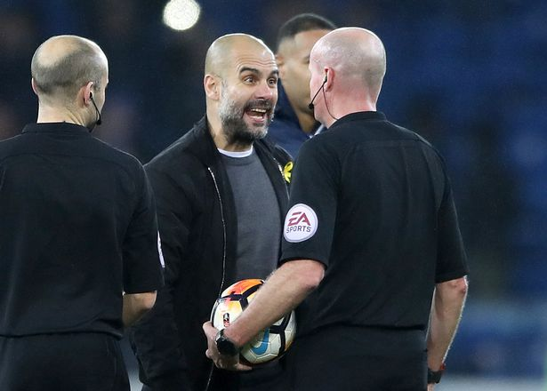 Pep Guardiola confronts Lee Mason at the final whistle.