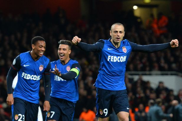 Martial and Berbatov celebrate after the latter scores for Monaco at Arsenal