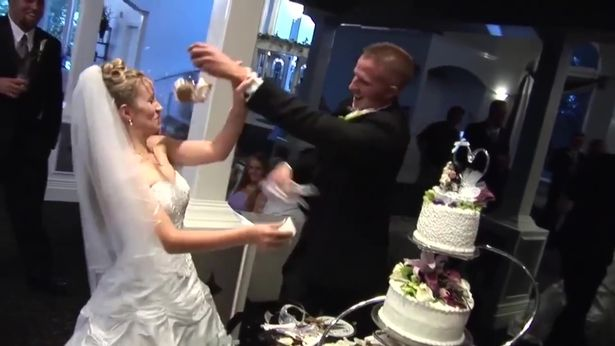 She tries to retaliate by ramming cake back into his face, too