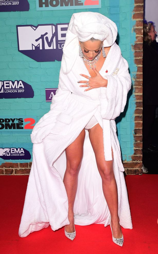 Rita Ora hits the red carpet in DRESSING GOWN and TOWEL as she arrives to host the MTV EMA's 2017