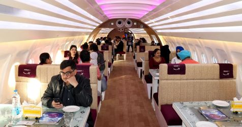 restaurant aeroplane into inside converted cabin eat airbus turned caters fly won diners mirror agency boarding simulator gives pass virtual