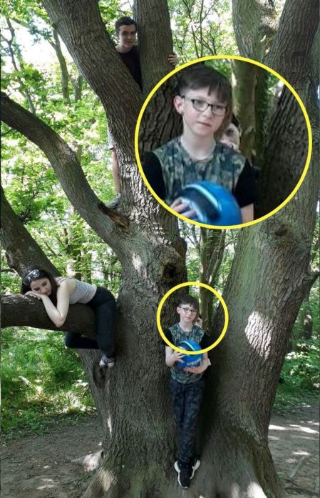 Laura Watson was enjoying a day in the woods when this creepy figure appeared in a picture she took of her son Byrin, nine, playing in a tree