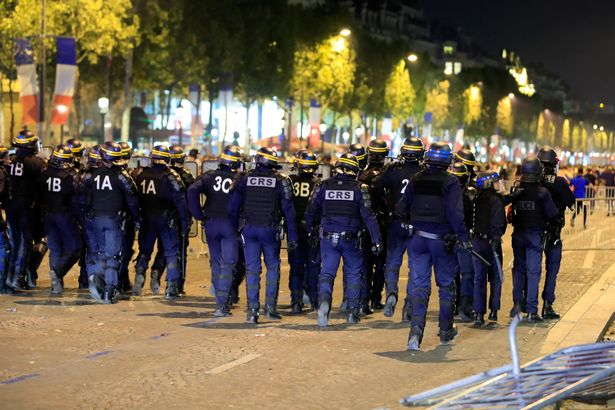 French football fans clash with riot police in Paris after Les Bleus defeat Belgium to reach World Cup final