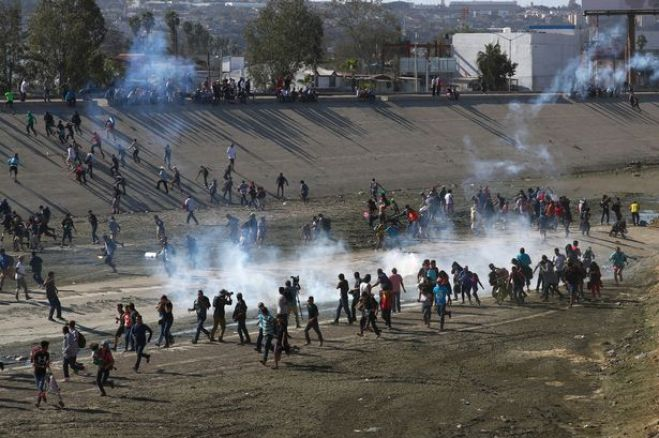 https://i0.wp.com/i2-prod.mirror.co.uk/incoming/article13644855.ece/ALTERNATES/s615b/0_Migrants-run-from-tear-gas-thrown-by-the-US-border-patrol-near-the-border-fence-between-Mexico-an.jpg?resize=659%2C438&ssl=1