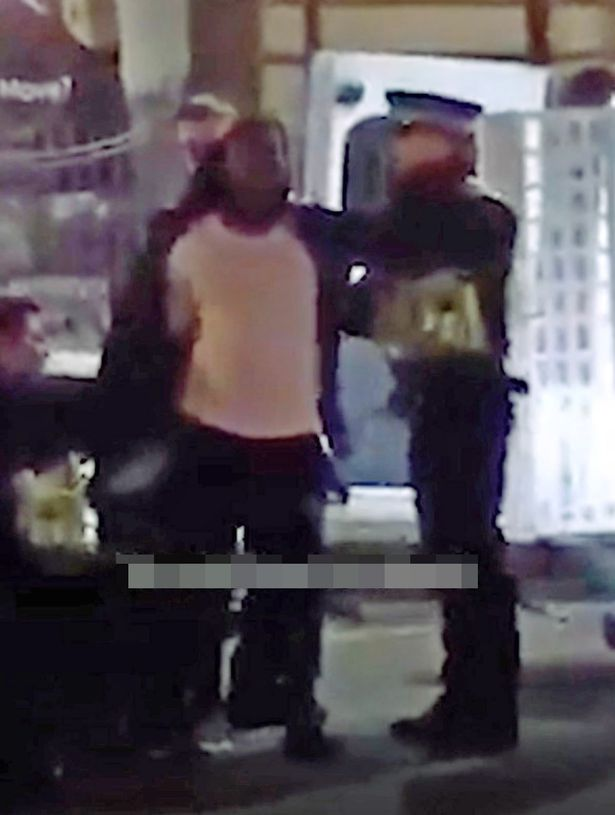 Footage shows a suspect surrounded by police following the New Year's Eve attack