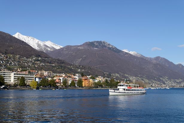 0_PAY-Excursion-boat-on-Lake-Maggiore-with-the-city-of-Locarno-Ticino-Switzerland Brit, 22, Found Dead In Luxury Hotel Room With Boyfriend Held By Police