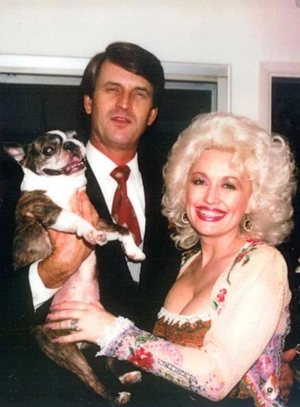 Dolly Parton pictured with husband Carl and their beloved pet dog