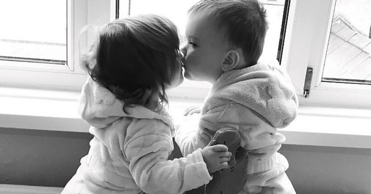 Heartbreaking photo of twins kissing goodbye while one with cancer goes on treatment