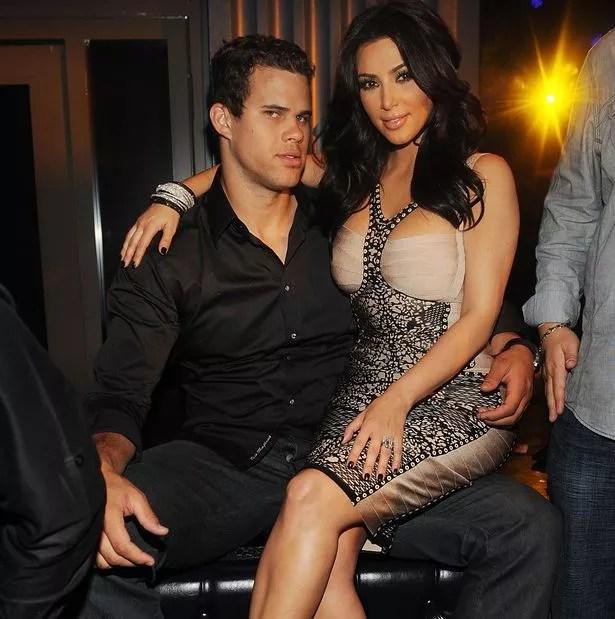 Kim Kardashian sits on Kris Humphries' lap