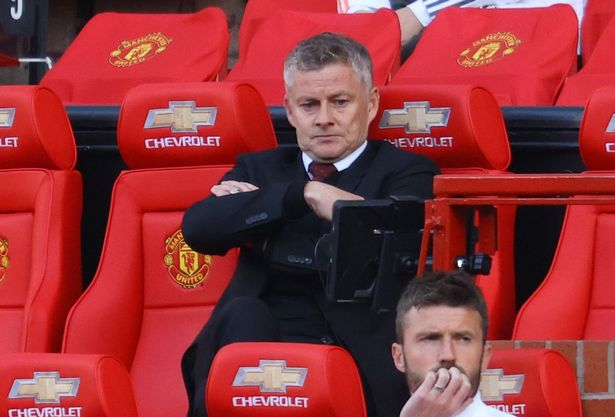 Manchester United boss Ole Gunnar Solskjaer looking cross, with arms folded, watching his team play