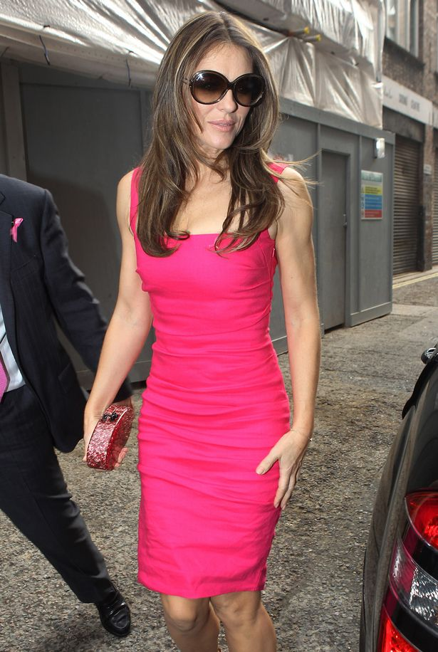 Liz Hurley deals with break up from Shane Warne at a breast cancer benefit  Mirror Online