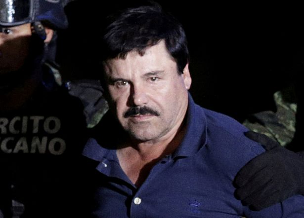 0 PAY FILE PHOTO Recaptured drug lord Joaquin El Chapo Guzman is escorted by soldiers at the hangar bel