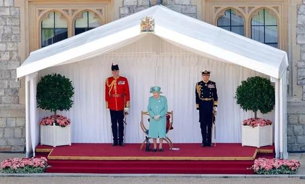 Queen Elizabeth II, accompanied by Lieutenant-Colonel Michael Vernon