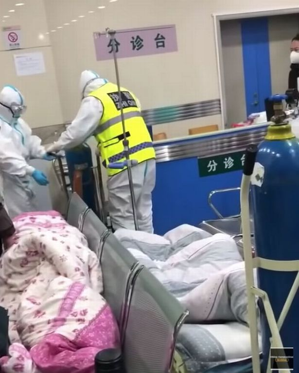 Medics work in a hospital in Wuhan during the coronavirus outbreak