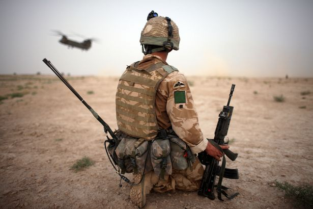 A British paratrooper pictured in Afghanistan in 2008