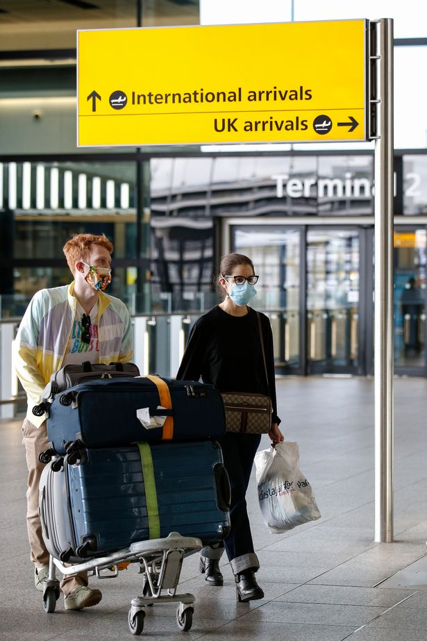 Travellers exit Heathrow Airport Terminal