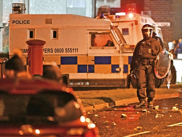 PSNI Land Rovers move in as rioting broke out overnight