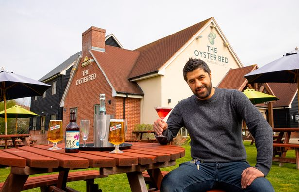 Pub manager Adem Insel gets ready for customers to return at The Oyster Bed, Whitstable, Kent
