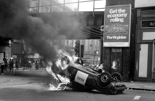 A police car blazes at the corner of Atlantic Road and Brixton Road South London in an outbreak of violence during the Britxon riots