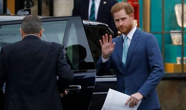 Prince Harry waving from a car