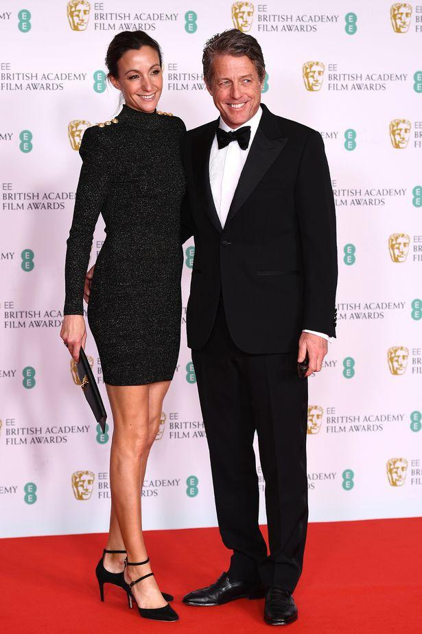 Hugh Grant and his wife Anna Elisabet Eberstein