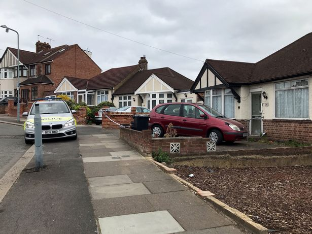 The police cordon outside a bungalow on Rushden Gardens in , east London, where an elderly lady was found dead in a bathtub on Friday