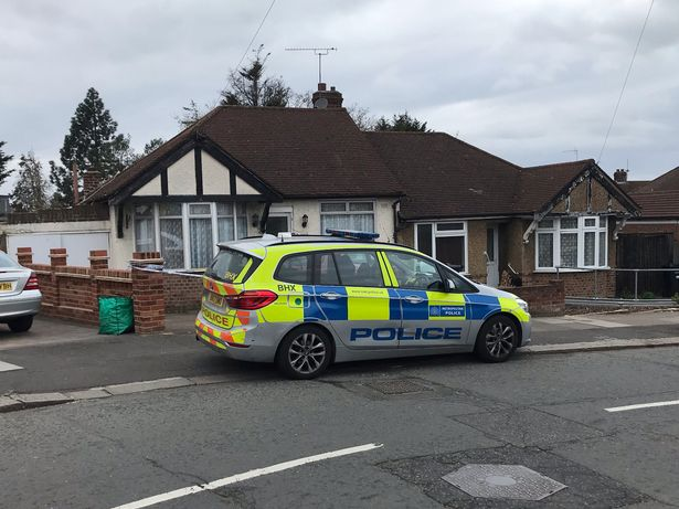 The police cordon outside a bungalow on Rushden Gardens in Ilford, east London, where an elderly lady was found dead in a bathtub