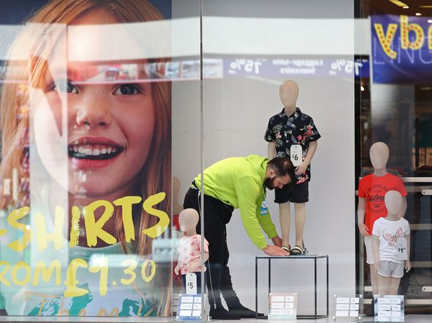 The finishing touches are made to a window in a Primark store on Oxford Street, central London,