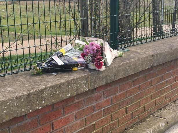 Flowers left at the scene outside Morrisons in Bilston after a newborn baby was discovered dead in the car park