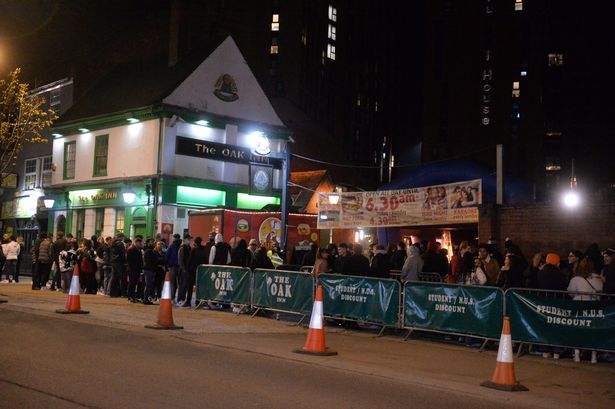 People line up outside the Oak Inn in Coventry