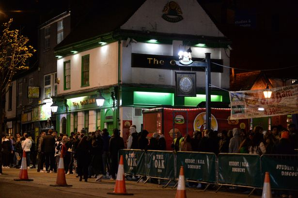 People queueing outside The Oak Inn in Coventry