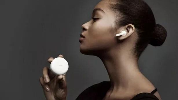 Woman wearing LG Tone Free FN7 earbuds