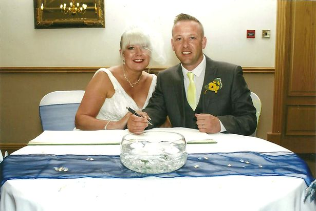 Claire and David Burke on their wedding day in 2013
