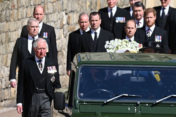 Members of the Royal Family follow the hearse, a specially modified Land Rover