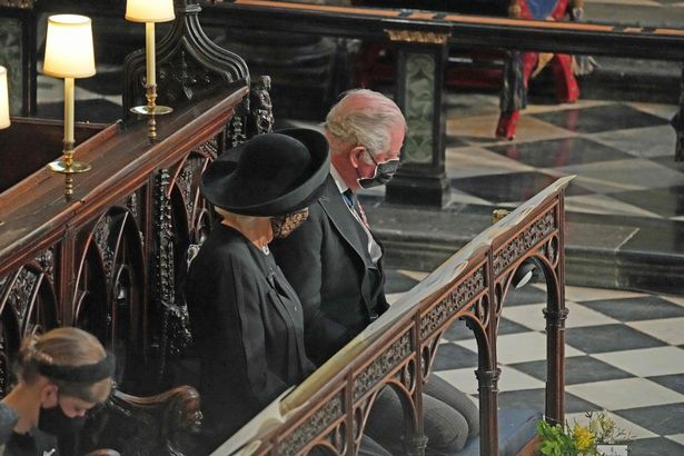 Camilla and Charles inside St George's Chapel in Windsor Castle yesterday