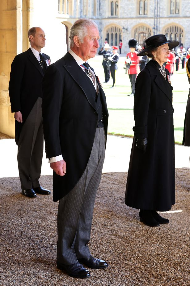 Princess Anne stands beside her brother, Prince Charles