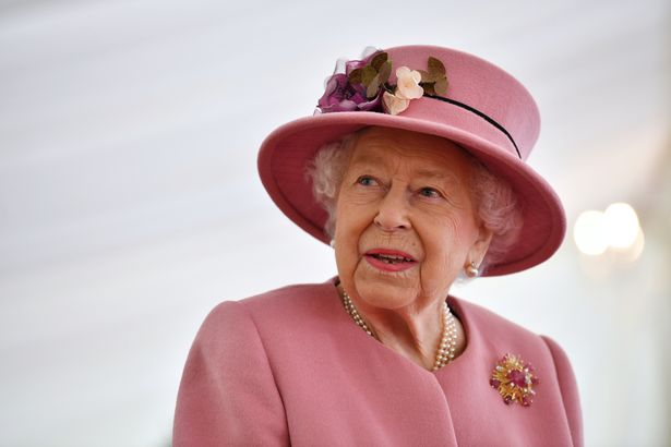 Britain's Queen Elizabeth II speaks with staff during a visit to the Defence Science and Technology Laboratory (Dstl) at Porton Down science park on October 15, 2020 near Salisbury, England