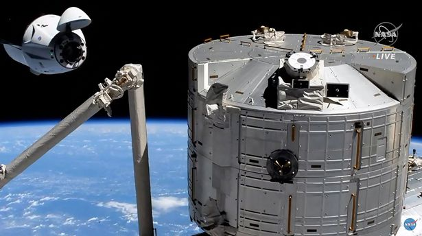 The SpaceX's Crew Dragon spacecraft at 20 metres of the docking access of the International Space Station